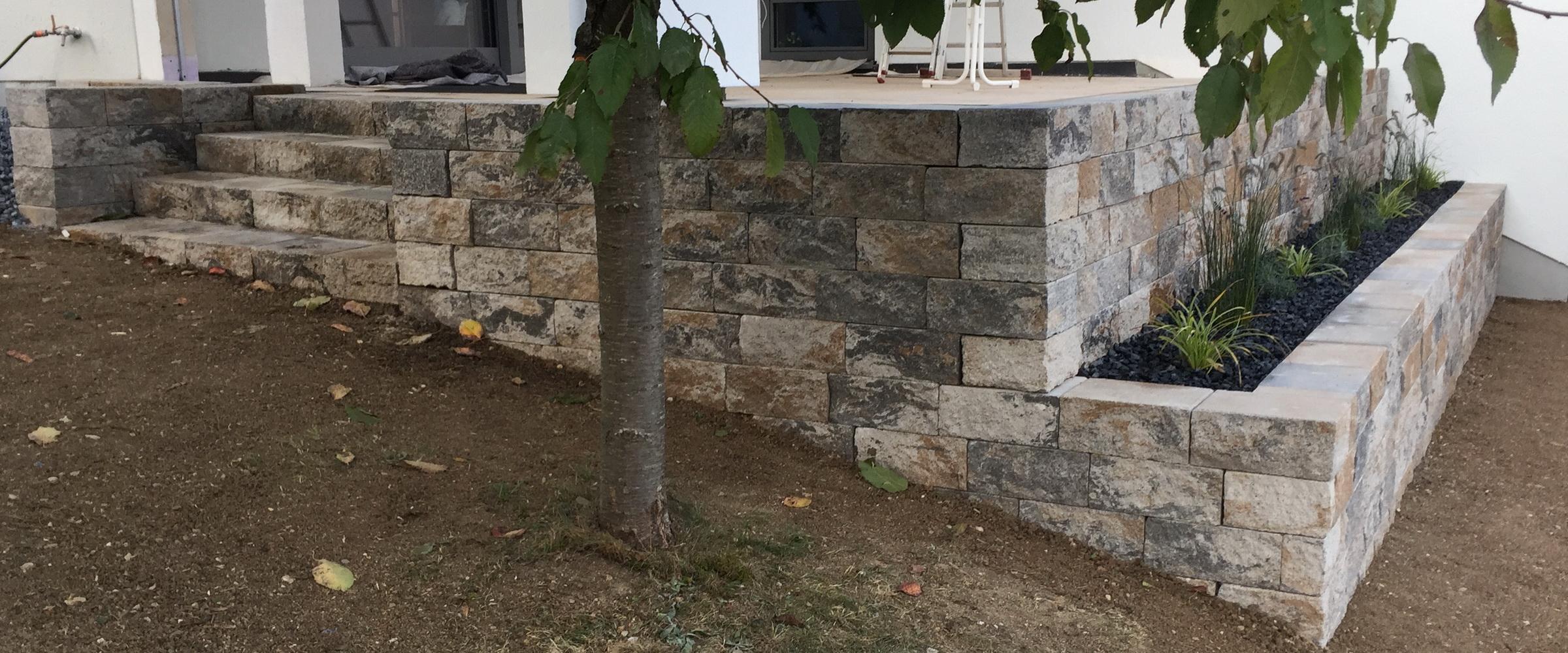 Setzen Sie Ihre Außenanlagen mit Betonsteinen aus Muschelkalkmix in Szene